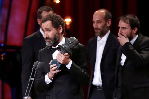 Aitor Arregi, Andoni de Carlos, Jon Garao y Jose Mari Goenaga recogen el Goya a Mejor guion origina 2018 por 'Handia'.