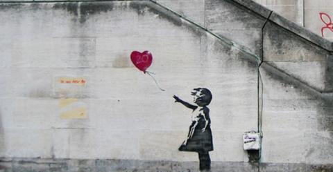 Grafiti de Banksy en el muro de Israel.
