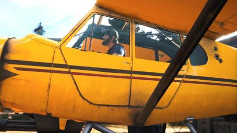 Un personaje de Far Cry 5 se sube a un avión de hélices.