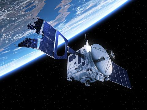 Una ilustración de un satélite dañado por la basura espacial.