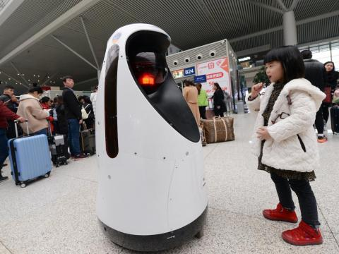 6. Installing 'robot police' in train stations that scan people's faces and match those of wanted fugitives — like this one in Zhengzhou, central China.