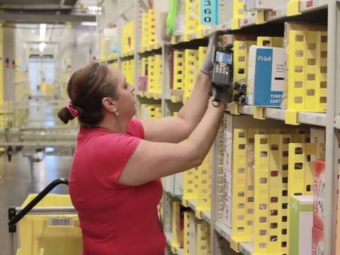 An Amazon worker scanning items.