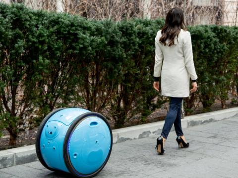 The company that invented the Vespa scooter is now testing this amazing luggage-hauling robot