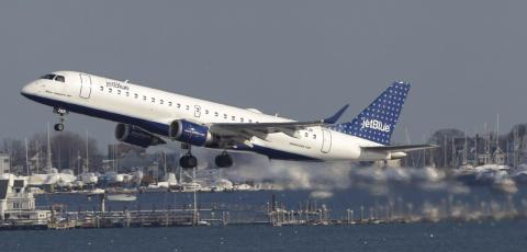 JetBlue Embraer E-Jet takes off at Logan International Airport in Boston