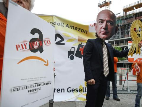 A person imitating Bezos at a demonstration outside Axel Springer's Berlin offices.