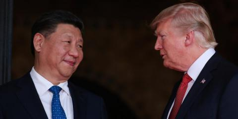 President Donald Trump welcomes Chinese President Xi Jinping at Mar-a-Lago state in Palm Beach, Florida.