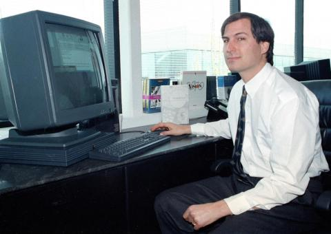 In this April 4, 1991, photo, Steve Jobs of NeXT Computer Inc. poses for the press with his NeXTstation color computer at the NeXT facility in Redwood City.