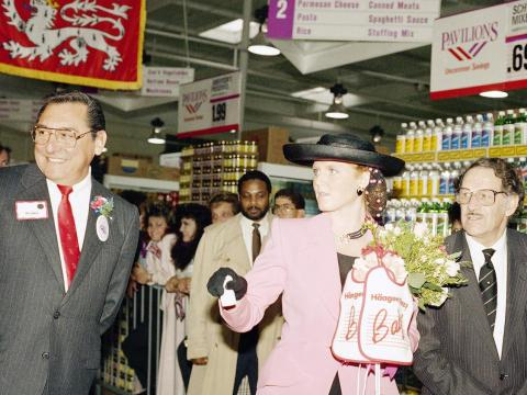 The Duchess of York holds some flowers and a couple of baby bibs as she tours the Vons Pavilions supermarket in Arcadia, California, February 29, 1988.