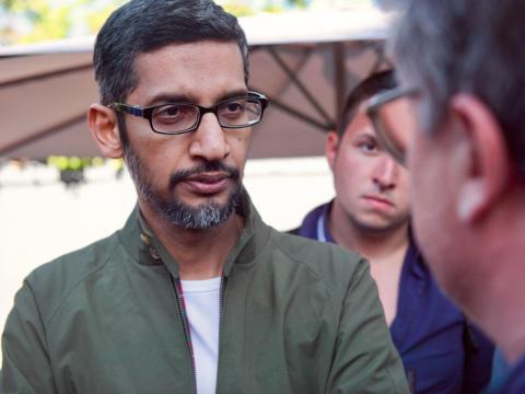 Google CEO Sundar Pichai speaks with reporters at th