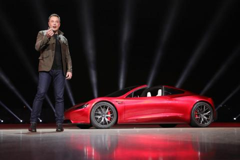 Elon Musk with the new Tesla Roadster.