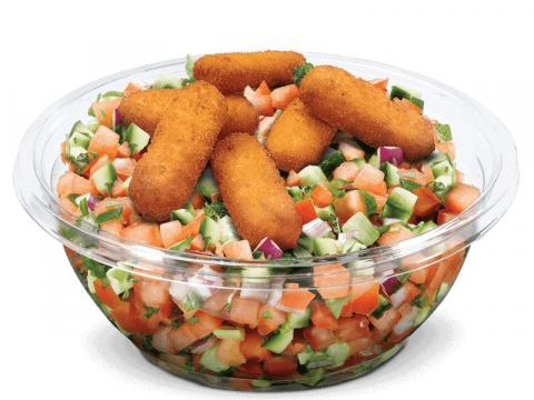 For one of the 15 salad options on McDonald's Israel's menu, fresh chopped vegetables are topped with olive oil, lemon, and fried corn sticks.