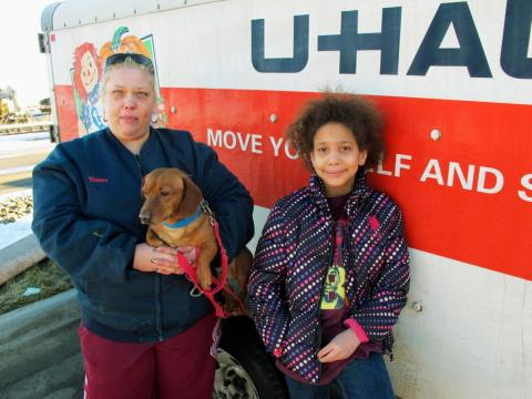 The town's population has started to dip in the past two years as uncertainty about its future grows. Yvonne Niess and her daughter, pictured below, left Williston for Atlanta, Georgia, in 2016.