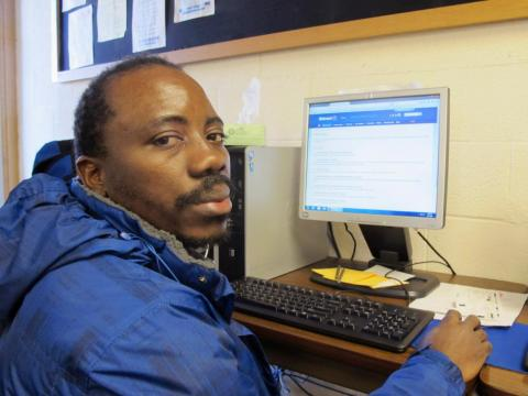 Williston's job service office is filled with people like Kennedy Mugemuzi, who moved to Williston from the Congo in 2015 and is working two full-time jobs to support his family.