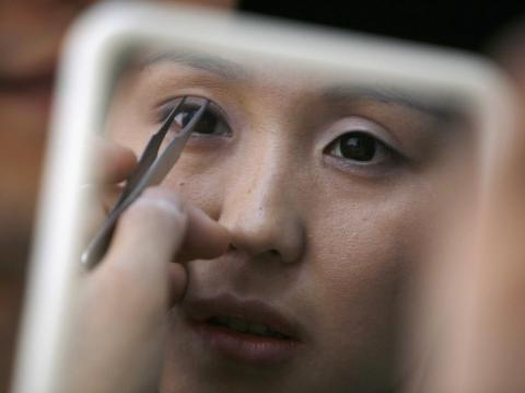 A woman receiving double-eyelid surgery.