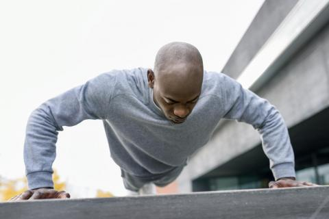 In between tasks, Sabir Peele (not pictured) does push-ups.