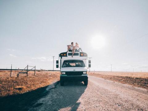 Austin Nicklas and Kenidy Springer in their mini school bus, Bessi.