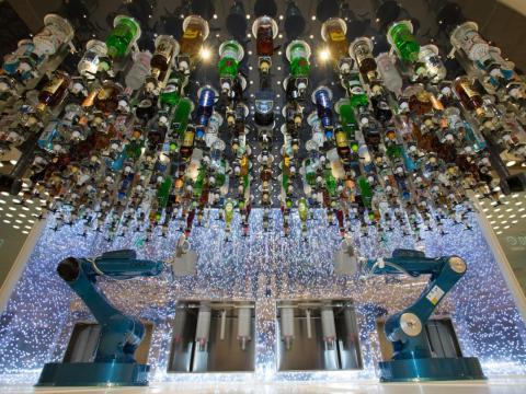 At the Bionic Bar, robot bartenders serve passengers drinks.