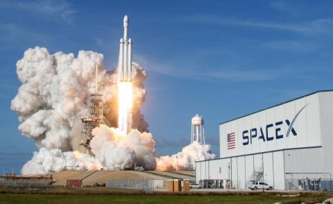 SpaceX's 23-story-tall Falcon Heavy rocket thunders toward space during its first launch in February 2018.