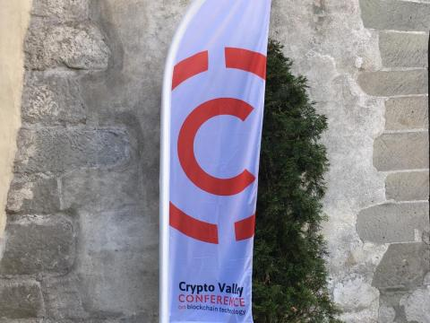 A flag set out for the Crypto Valley Conference in central Zug.