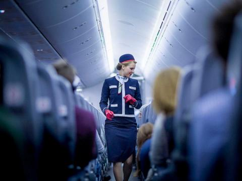 "But the job isn't a constant glitzy adventure, even if you're working in first class. The job can be frustrating, as many passengers dismiss flight attendants as ""waiters and waitresses on a plane,"" according to longtime Delta"
