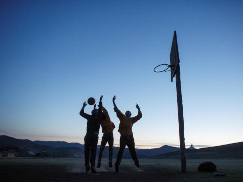 Monks at the monastery wind down by playing basketball at sunset …