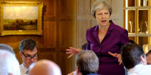Theresa May addresses members of her cabinet at an all-day Brexit session in Chequers, the Prime Minister's country retreat in Buckinghamshire.