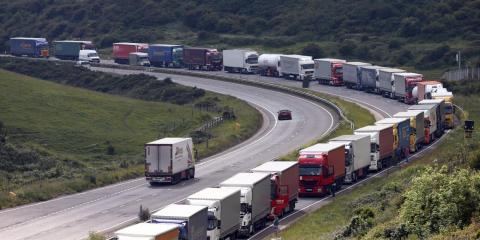 Trucks queue up as part of Operation Stack on June 23, 2015 in Dover, England. Ferry workers blockaded the port of Calais in a protest over job cuts earlier on Tuesday.