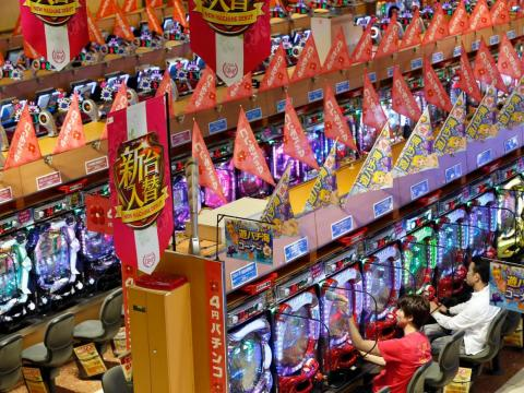 Visitors play Pachinko at a Dynam pachinko parlour in Honjo, north of Tokyo August 4, 2014.