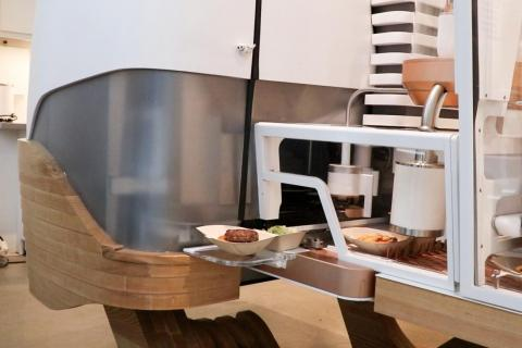 While the bun gets all the fixings, the robot grinds the meat to order. It takes place in this opaque case, so guests don't see the magic happen.