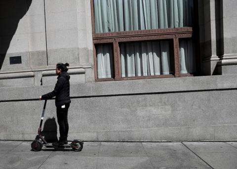 A user riding a Bird scooter on April 17 in San Francisco.