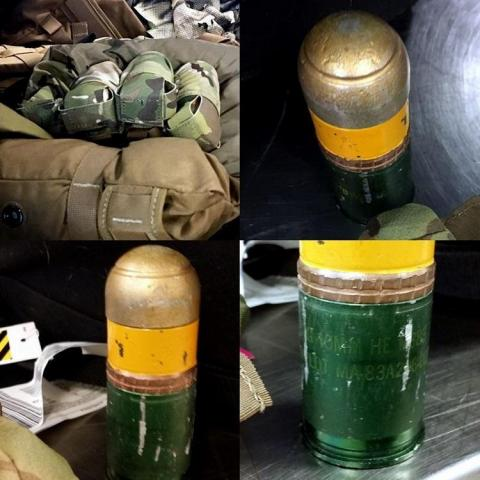 11. A collection of four 40mm grenades hidden inside a tactical vest