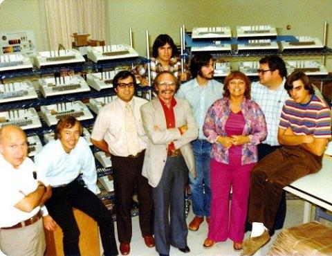 From left: Elmer Baum, Mike Markkula, Gary Martin, Andre Dubois, Steve Jobs, Sue Cabannis, Mike Scott, and Don Breuner. Standing in the rear is Mark Johnson. On all sides are Apple IIs waiting to be shipped.