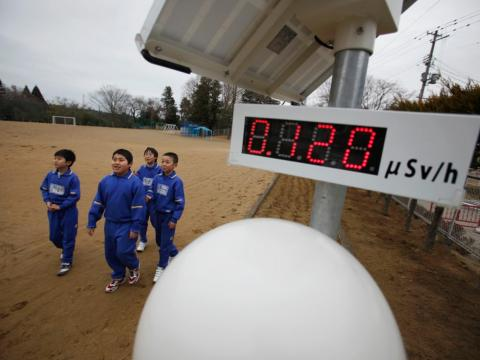 About 13 miles away from the Fukushima Daiichi nuclear power plant in Japan, kids at Omika Elementary School come face to face with Geiger counters ticking off local radiation levels.