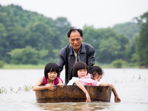 About 600 miles south, kids in the flood-prone towns of Jiangxi Province must rely on parents to make accommodations when roads turn into streams.