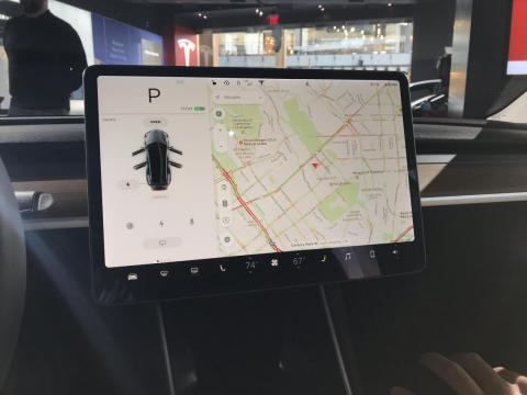 The absurdly large touchscreen inside of a Tesla vehicle.