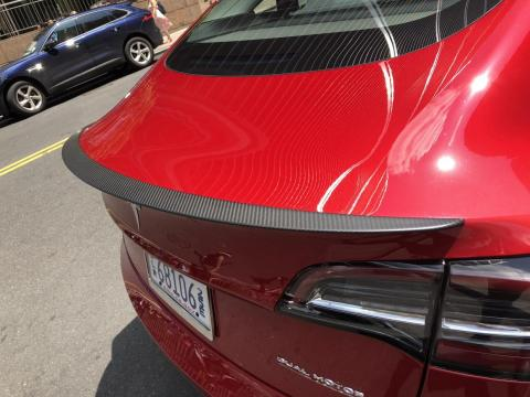 8. The Tesla Model 3 Performance also gets some goodies the standard Model 3 doesn't, including lowered suspension for better handling, a carbon-fiber spoiler for better aerodynamics, and aluminum alloy pedals and brakes.