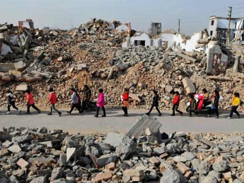 With all the country's rapid infrastructure growth, kids in China's Henan province often walk through demolition sites to get to school.
