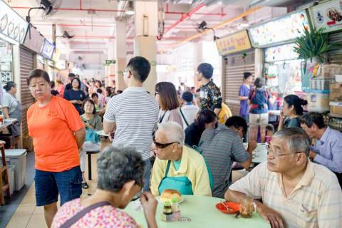 """The best places to try Singaporean cuisine (and a shortcut to understanding the city-state's culture) is in """"hawker centers."""" Built in the 1950s and 1960s to make street-food more sanitary, while preserving the local food culture,"""