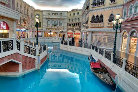 "In the center of the mall, there's a manmade ""river"" (modeled after the famous one in Venice), where shoppers can take gondola rides."