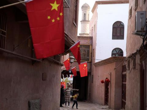 Corridor of the old city district where Chinese national flags are prominently hung in Kashgar in western China's Xinjiang region.
