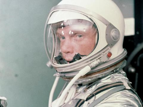 Astronaut John Glenn in a silver Mercury pressure suit, preparing for launch on February 20, 1962.