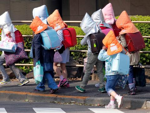 In earthquake- and tsunami-prone Tokyo, some schools ask parents to give their kids protective headgear in case a natural disaster strikes.
