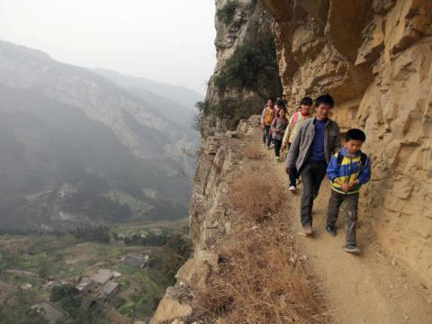 Equally treacherous are the cliffside walks families take in Guizhou province in order to make their way to Banpo Primary School.
