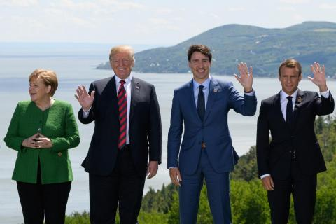 German Chancellor Angela Merkel, US President Donald Trump, Canadian Prime Minister Justin Trudeau, and French President Emmanuel Macron at the G7 summit.