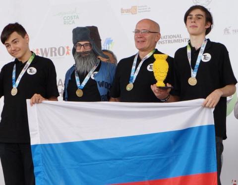 Left to right: Maksim Mikhailov and his team: Daniil Nechaev, Igor Lositsky and Gleb Zagarskikh, as they accept the gold medal at the 2017 World Robot Olympiad.