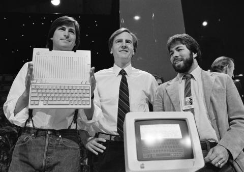 Steve Jobs, John Sculley, and Steve Wozniak launch the Apple IIc in 1984.