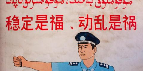 """This mural in Yarkland, Xinjiang, photographed in September 2012, says: """"Stability is a blessing, instability is a calamity."""""""