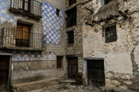 """Nearly all of the homes in the village are abandoned, and """"For Sale"""" signs still hang on some of them."""