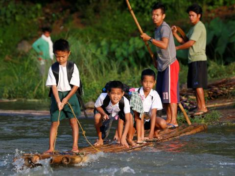 Other Philippine children have taken to using homemade rafts, fashioned out of bamboo, to reach the remote Casili Elementary School in Rodriguez, Rizal province.