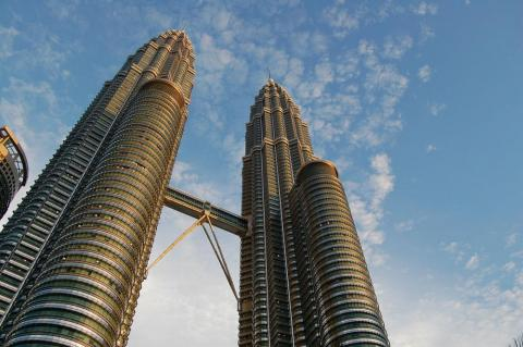 The Petronas Twin Towers, located in Malaysia, was constructed in 1999.